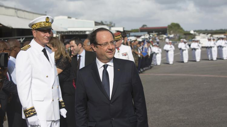French President Hollande arrives at the airport in Cayenne
