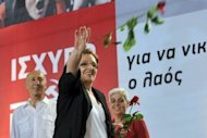 Greek Communist party leader Aleka Papariga throws flowers to supporters during the party&#39;s main pre-election rally in Athens on June 15. Eurogroup chief Jean-Claude Juncker warned a radical left victory in Greece would have &quot;unpredictable&quot; consequences for the eurozone as Greeks fed up with austerity prepared for Sunday&#39;s elections