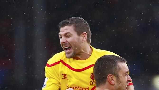 Liverpool's Steven Gerrard celebrates with team-mate Rickie Lambert after Lambert scored a goal against Crystal Palace during their English Premier League soccer match at Selhurst Park in London