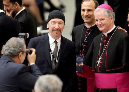 U2 guitarist The Edge makes history as he rocks Sistine Chapel for cancer