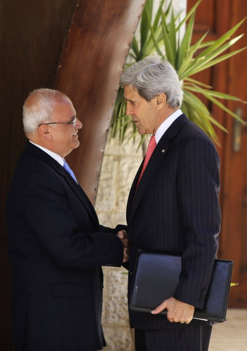 U.S. Secretary of State Kerry shakes hands with Palestinian Chief Negotiator Erekat before a meeting in Ramallah