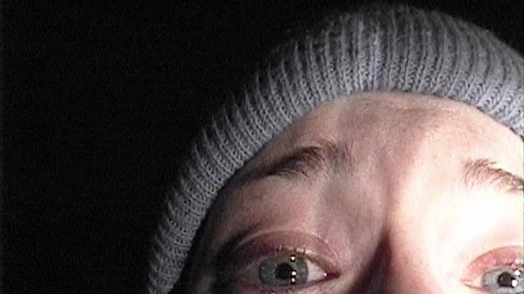 "FILE - in this publicity file photo provided by Artisan Entertainment, Heather Donahue turns the camera on herself during her confession scene from the horror film ""The Blair Witch Project."" (AP Photo/Artisan Entertainment, file)"