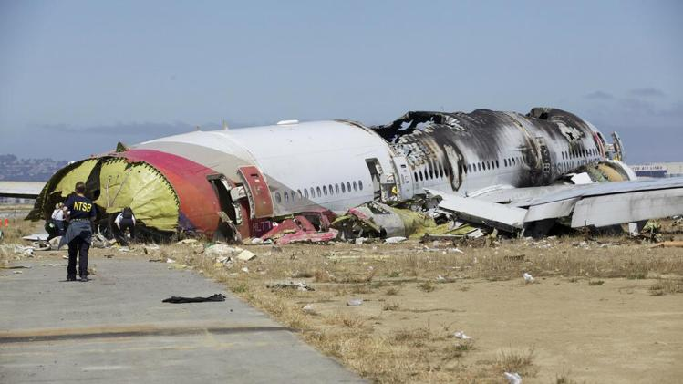 NTSB handout file photo shows the wreckage of Asiana Airlines Flight 214 that crashed at San Francisco International Airport