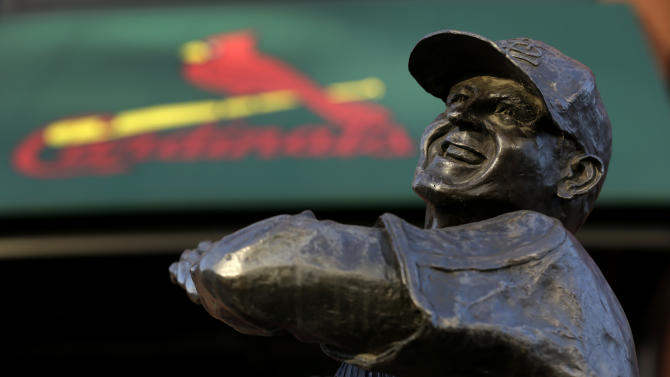 """FILE - In this Jan. 20, 2013 file photo a statue of former St. Louis Cardinals baseball player Stan Musial stands outside Busch Stadium in St. Louis. State and federal lawmakers proposed legislation Wednesday, Jan. 23, 2013 that would name a new bridge the Stan Musial Memorial Bridge — some are already dubbing it the """"Stan Span."""" The bridge carrying Interstate 70 traffic is expected to open in 2014.  (AP Photo/Jeff Roberson, File)"""