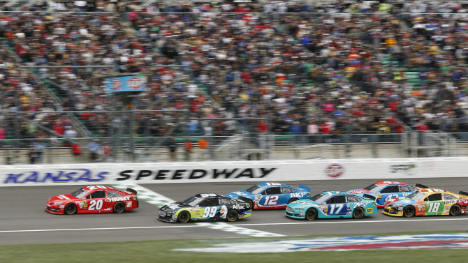 Sprint Cup Series driver Matt Kenseth (20) leads the field as the green flag drops to start a NASCAR Sprint Cup series race at Kansas Speedway in Kansas City, Kan., Sunday, April 21, 2013. (AP Photo/Orlin Wagner)