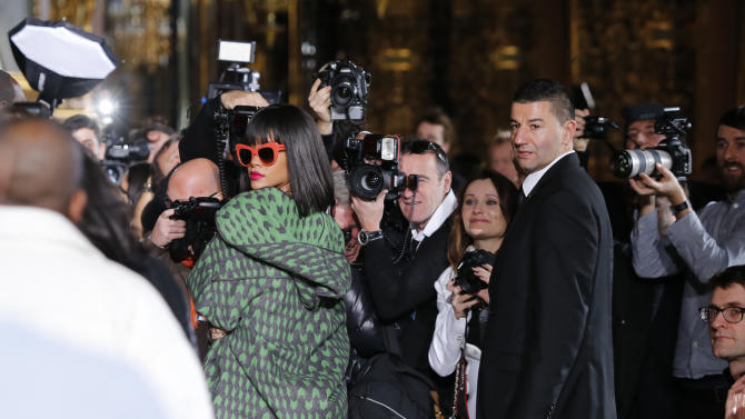 Singer Rihanna arrives at Stella McCartney's ready-to-wear fall/winter 2014-2015 fashion collection presented in Paris, Monday, March 3, 2014. (AP Photo/Jacques Brinon)