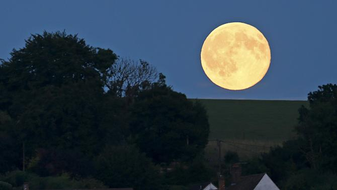 A full moon, known as Blue Moon is seen over Loosely Row, near Princes Risborough