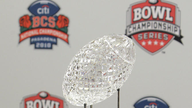 FILE - In this Jan. 5, 2012, file photo, the BCS Coaches' Trophy is displayed during a media availability on Newport Beach, Calif. A tentative plan for the new college football postseason calls for a Pac-12 or Big 12 team to face the best team from a group of five conferences, including the Big East. (AP Photo/Jae C. Hong, File)