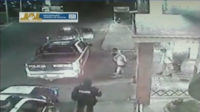 In this frame grab taken from video filmed by a surveillance camera on Jan 20, 2012, and released by the Jalisco state prosecutors' office on June 14, 2012, three men walk away from a hotel in their underwear with their hands tied behind their backs and some blindfolded, as they are led by men dressed in police uniforms toward police vehicles in Lagos de Moreno, Mexico. The men later were found asphyxiated and beaten to death. Jalisco prosecutors' spokesman Lino Gonzalez said Thursday June 14, 2012 that the five officers, their commander and the local police chief in Lagos de Moreno have been detained pending charges. (AP Photo/Jalisco state prosecutors' office)