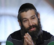 FILE - This Sept. 3, 2010 file photo shows Hassidic raggae musician Matthew Paul Miller, aka Matisyahu, during an interview in Budapest, Hungary. The 33-year-old Matisyahu is far from the one who lived for years in a modest apartment in Crown Heights, the Orthodox Jewish neighborhood in Brooklyn. He&#39;s moved his wife and three sons to Los Angeles, favors pastels over dark suits, ditched the yarmulke, changed his management team, and is self-releasing his music. This month, he releases his fourth studio CD, &quot;Spark Seeker,&quot; a fresh sound produced by Kool Kojak with reggae, hip-hop and electronica layered over Middle Eastern instruments and rhythms. (AP Photo/MTI, Zsolt Demecs, file)