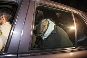 Nakoula Basseley Nakoula is escorted in a Los Angeles County Sheriff's vehicle from his home by officers in Cerritos, California