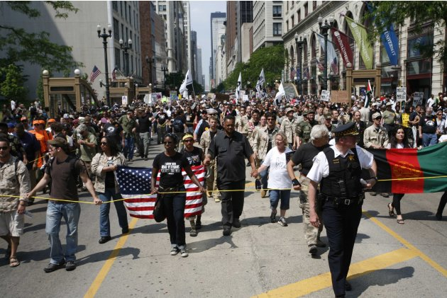 Reverend Jesse Jackson Sr. leads over 10,000 protestors as they march through downtown Chicago during an anti-NATO protest march in Chicago