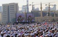 People wait for Pope Benedict XVI to attend an open-air mass at Beirut&#39;s waterfront on the final day of his visit to Lebanon. Pope Benedict XVI prayed on Sunday that Middle East leaders work towards peace and reconciliation, stressing again the central theme of his visit to Lebanon, whose neighbour Syria is engulfed in civil war