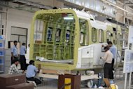 Indian technicians are seen working at helicopter cabin manufacturing facility, at Tata Advanced Systems Limited (TASL) in Hyderabad. India's industrial output unexpectedly shrank in March by 3.5 percent as Asia's third-largest economy was hit by declining domestic demand and falling exports, according to official data