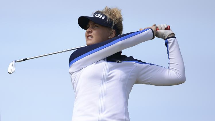 Hull of Britain plays her second shot at the 9th hole during the women's British Open golf tournament at the Royal Birkdale Golf Club in Southport
