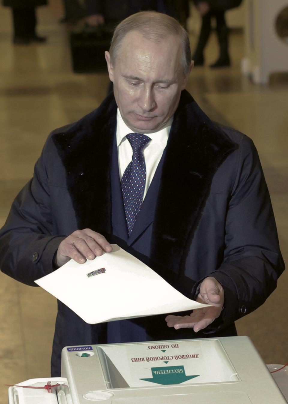 Russian Prime Minister Vladimir Putin casts his ballot at a polling station in Moscow,  Russia, Sunday, Dec. 4, 2011. Russians cast their ballots with muted enthusiasm in national parliament elections on Sunday, a vote that opinion polls indicate could water down the strength of the country's dominant party. (AP Photo/Ivan Sekretarev)