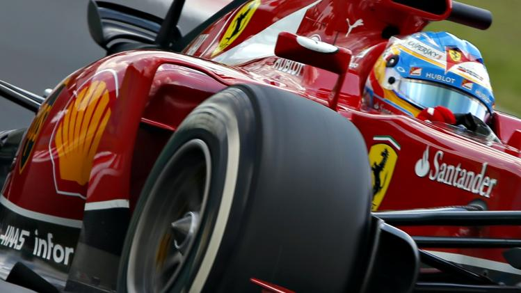 Ferrari Formula One driver Alonso of Spain drives during the qualifying session of the Hungarian F1 Grand Prix at the Hungaroring circuit