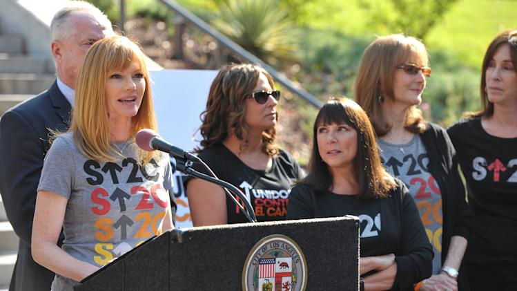"Actress Marg Helgenberger, left, appears at the Stand Up To Cancer Day announcement at Los Angeles City Hall on Tuesday, Sept. 4, 2012. Councilmember Paul Koretz and the City of Los Angeles held the news conference to declare Friday, Sept. 7 as the official ""Stand Up To Cancer Day"" in Los Angeles.  (Photo by John Shearer/Invision/AP)"
