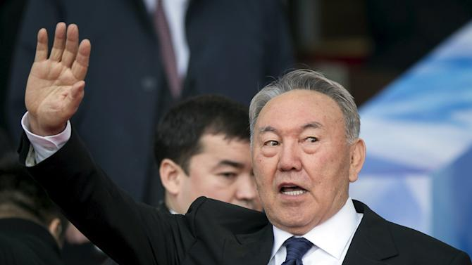 Kazakhstan's President Nazarbayev waves to audience during an election campaign rally at a stadium in Almaty