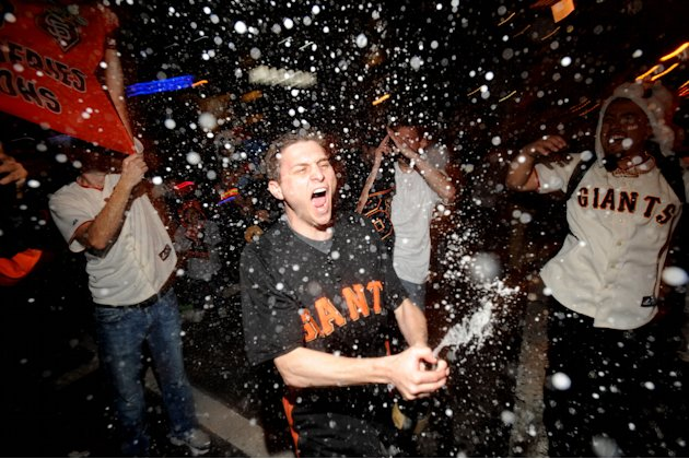 San Francisco Giants fan David Zweig celebrates outside PacBell Park on Sunday, Oct. 28, 2012, in San Francisco after the Giants swept baseball's World Series against the Detroit Tigers. (AP Photo