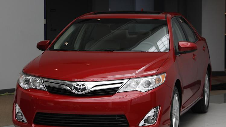 The 2012 Toyota Camry is unveiled during a news conference in Dearborn, Mich., Tuesday, Aug. 23, 2011. While it promises new technology and other upgrades, America's best-selling car faces a fight to stay on top with its first redesign of the Camry in five years (AP Photo/Paul Sancya)