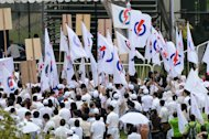Supporters of the Peolpe&#39;s Action Party (PAP) are seen gathering at the nomination center in Singapore, on January 16, 2013. Singapore&#39;s ruling party suffered a fresh rebuke from voters on Saturday when it lost a parliamentary by-election despite promises of more reforms to appease a restive electorate