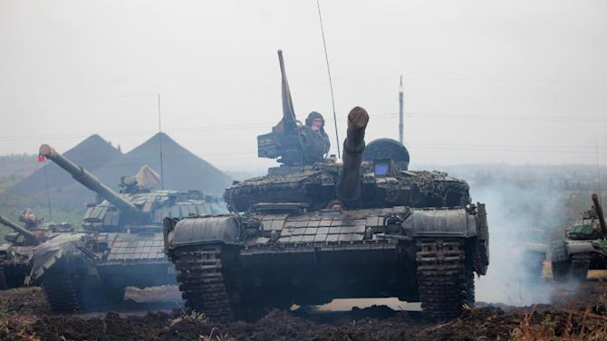 Pro-Russian separatists take part in a military competition between tank units near the town of Torez in the Donetsk region on September 14, 2015