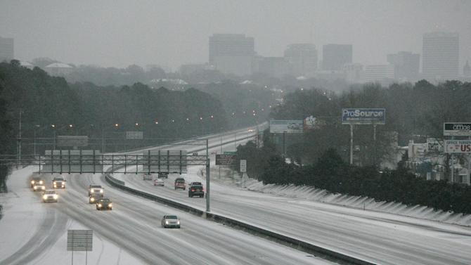Ice and snow cover Interstate 26, early Wednesday, Feb. 12, 2014, in Columbia, S.C. Gov. Nikki Haley again declared a state of emergency as emergency officials worried that as much as an inch of ice accumulating on trees and power lines Wednesday into Thursday could knock out powers to thousands, especially in the Midlands. (AP Photo/Mary Ann Chastain)