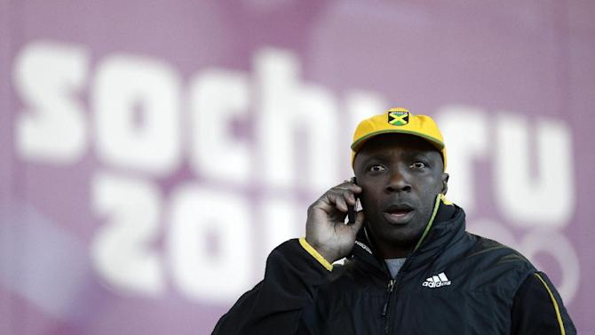 Winston Watts, the driver for JAM-1 of Jamaica, speaks on the phone after arriving at the sliding center during a training session for the men's two-man bobsled at the 2014 Winter Olympics, Wednesday, Feb. 5, 2014, in Krasnaya Polyana, Russia. Watts and his team were unable to practice because the Jamaican team equipment and luggage did not arrive in Sochi. (AP Photo/Natacha Pisarenko)