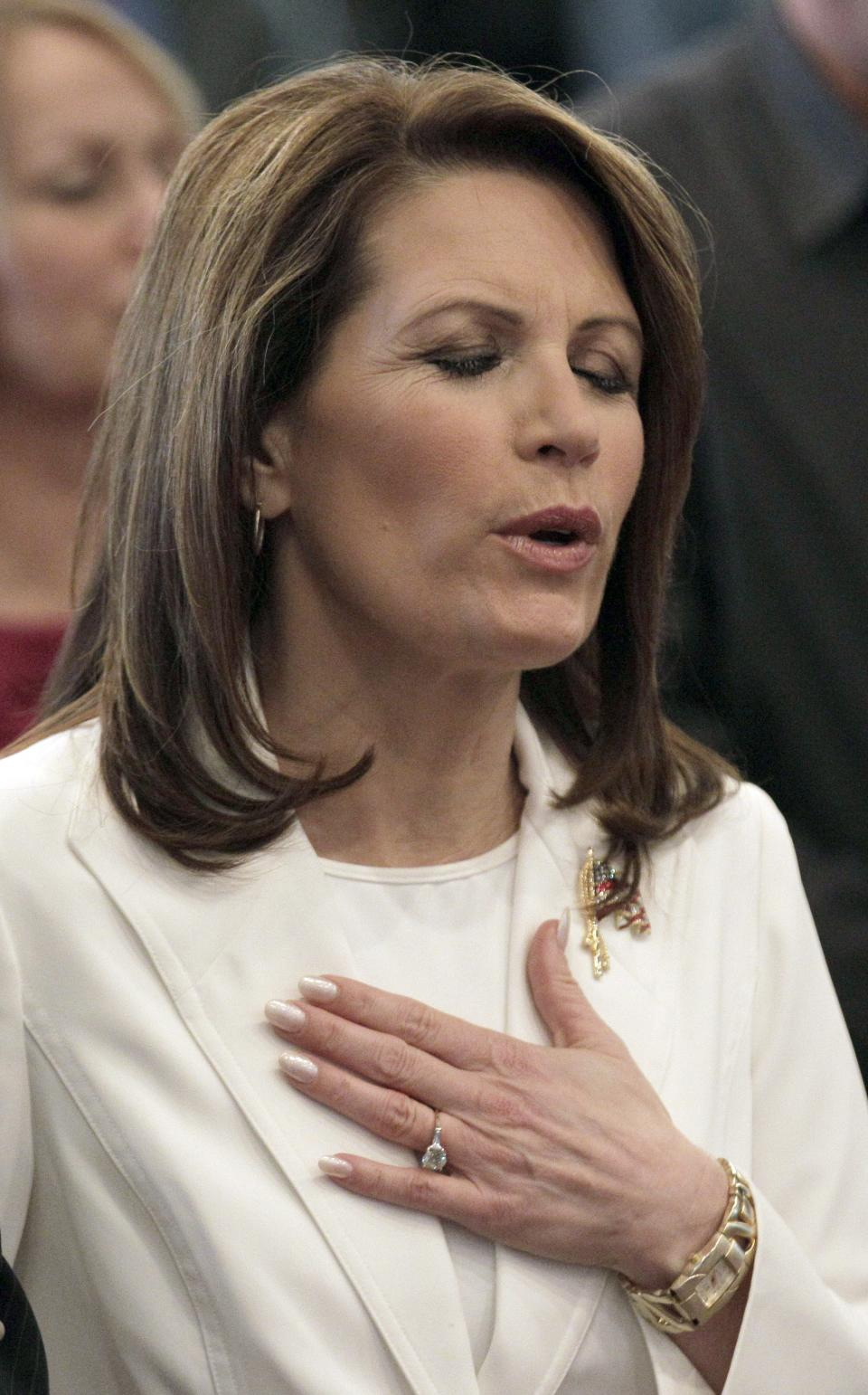 Republican presidential candidate, Rep. Michele Bachmann, R-Minn., sings with the congregation during a campaign stop at Jubilee Family Church in Oskaloosa, Iowa, Sunday, Jan, 1, 2012. (AP Photo/Charlie Riedel)
