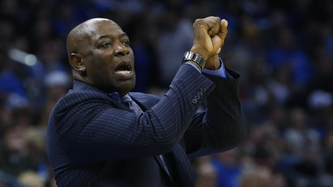 Sacramento Kings head coach Keith Smart gestures to his players during the second quarter of an NBA basketball game against the Oklahoma City Thunder in Oklahoma City, Friday, Dec. 14, 2012. (AP Photo/Sue Ogrocki)