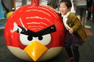 "A young girl plays at Shanghai's first Angry Birds Activity Park at Tongji University in Shanghai on October 31. The company behind ""Angry Birds"" said Wednesday it would open its first theme park in Asia next year at a site near Shanghai as it builds on the brand of the hugely popular game"