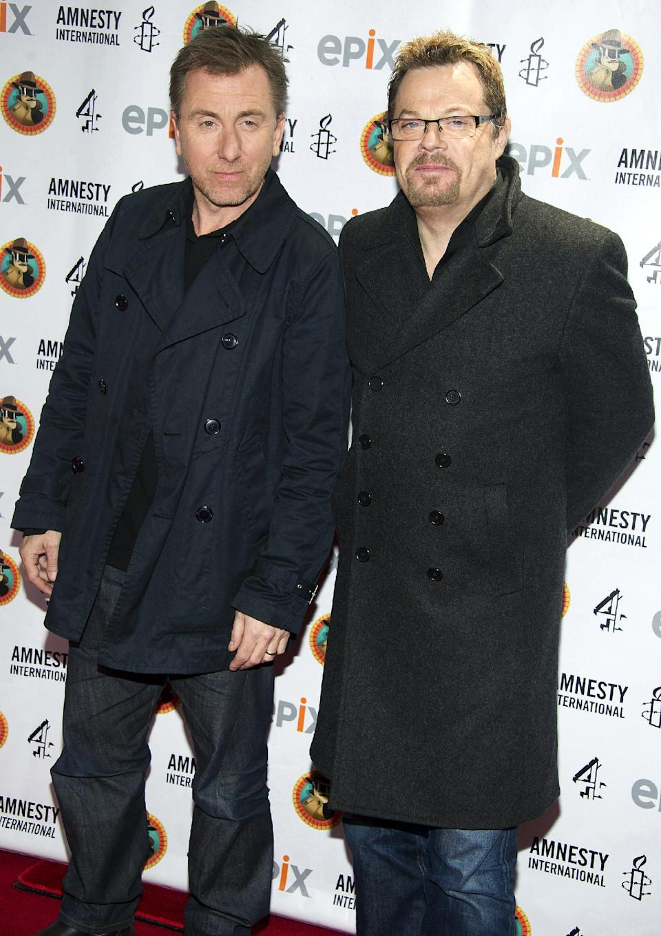 "Tim Roth, left, and Eddie Izzard arrive to Amnesty International's ""Secret Policeman's Ball"" in New York, Sunday, March 4, 2012. (AP Photo/Charles Sykes)"