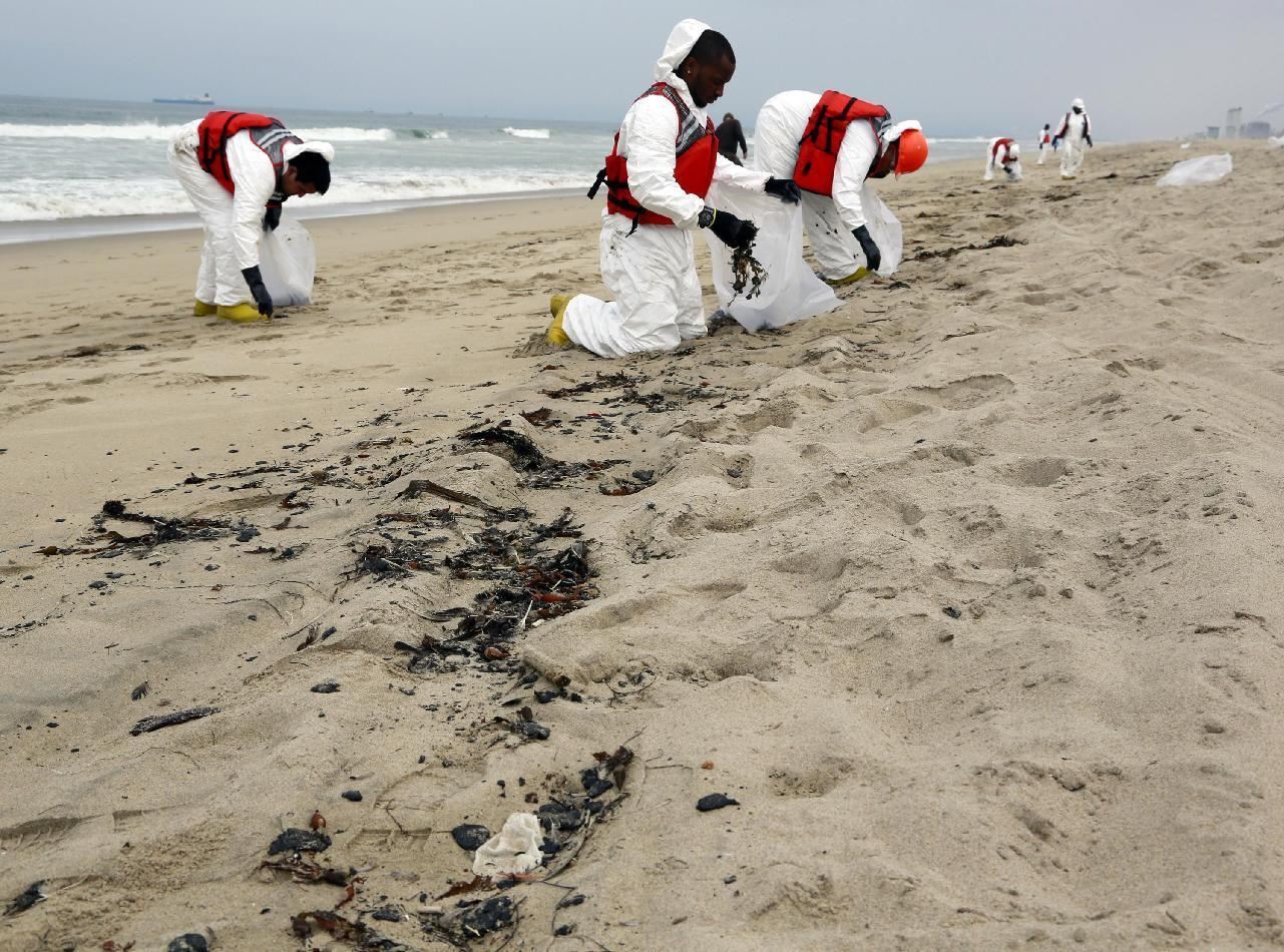 California beaches to remain closed after oily goo washes up