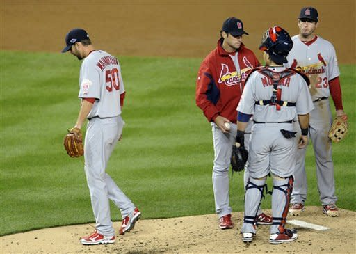 Cards score 4 in 9th, beat Nats 9-7, reach NLCS