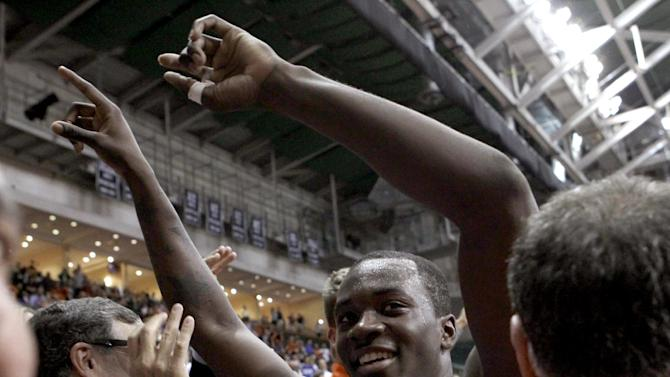 Miami's Durand Scott celebrates a 90-63 win over Duke in an NCAA college basketball game in Coral Gables, Fla., Wednesday, Jan. 23, 2013. (AP Photo/Alan Diaz)