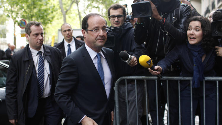 President-elect Francois Hollande arrives at the Socialist Party headquarters in Paris Wednesday May 9, 2012.  After winning the French Presidential Election, Hollande seems set to embark on a whir-wind introduction to international politics, with critical visits already being scheduled to Berlin, the US, and two top international summits. (AP Photo/Thibault Camus)