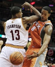 Cleveland Cavaliers' Tristan Thompson (13) and Phoenix Suns' Channing Frye (8) battle for a rebound in the first quarter of an NBA basketball game, Sunday, March 25, 2012, in Cleveland. (AP Photo/Tony Dejak)