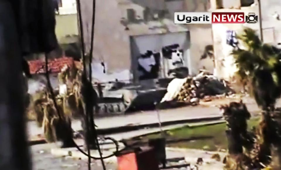 This image made from amateur video and released by Ugarit News Group Tuesday, Dec. 27, 2011, purports to show a Syrian military tank in Homs, Syria. (AP Photo/Ugarit News Group via APTN) THE ASSOCIATED PRESS CANNOT INDEPENDENTLY VERIFY THE CONTENT, DATE, LOCATION OR AUTHENTICITY OF THIS MATERIAL. TV OUT