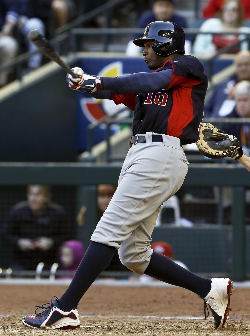 United States' Adam Jones connects with the ball in the ninth inning during a World Baseball Classic baseball game against Canada on Sunday, March 10, 2013, in Phoenix.  The United States defeated Canada 9-4. (AP Photo/Ross D. Franklin)