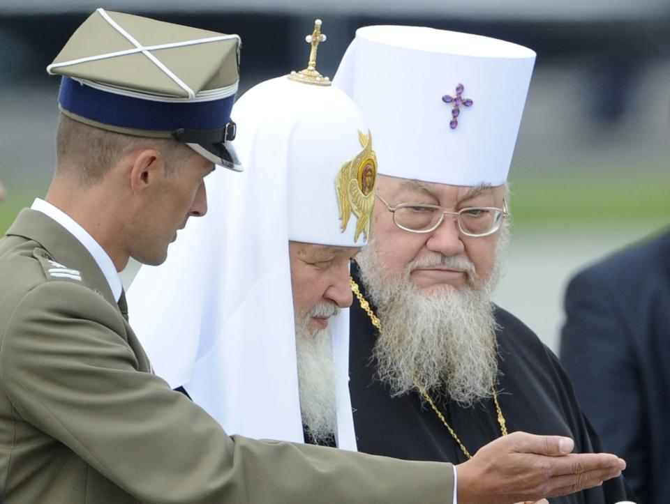 A Polish Army soldier show the way to Patriarch Kirill , leader of the Russian Orthodox Church, center and Sawa of Poland, right, after arrival at the Military Airport in Warsaw, Poland, Thursday, Aug. 16, 2012. Patriarch Kirill is in Poland on a four day official visit. (AP Photo/Alik Keplicz)