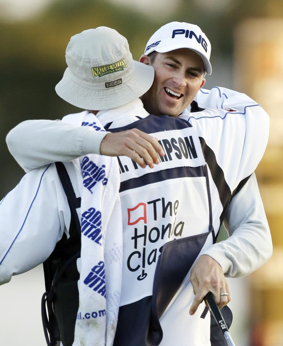 Michael Thompson, rear, hugs caddie Matt Bednarski after winning the Honda Classic golf tournament, Sunday, March 3, 2013, in Palm Beach Gardens, Fla. (AP Photo/Wilfredo Lee)