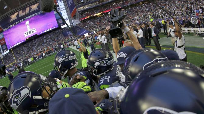 Seattle Seahawks players gather on the field for warm-ups before the NFL Super Bowl XLIX football game against the New England Patriots in Glendale