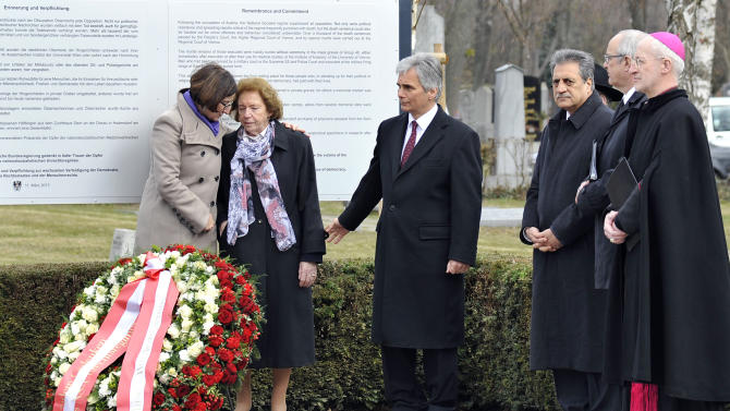"Interior Minister Johanna Mikl-Leitner, Resistance fighter Katharina Sasso, Austrian Chancellor Werner Faymann, President of Islamic Community Fuat Sanac, Protestant Bishop Michael Buenker and Catholic Bishop Franz Scharl, from left, attend the unveiling of a plaque honoring the thousands of Austrians killed by the Nazis for opposing them, before and after the so-called ""Anschluss"" at the Central Cemetary in Vienna, Austria, Monday, March 11, 2013. Austria's chancellor has urged fellow Austrians to strive to prevent a return of the political climate that allowed Nazi atrocities, in comments marking Germany's annexation of Austria 75 years ago. (AP Photo/Hans Punz)"