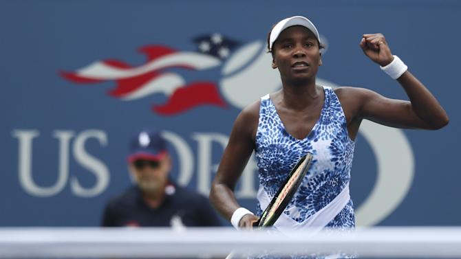 Williams of the U.S. celebrates a point against Puig of Puerto Rico during their match at the U.S. Open Championships tennis tournament in New York