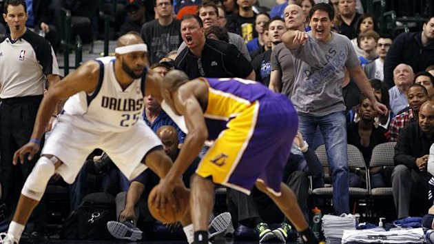 Dallas Mavericks owner Mark Cuban (R) reacts as guard Vince Carter (L) guards Los Angeles Lakers guard Kobe Bryant during the second half of their NBA basketball game in Dallas