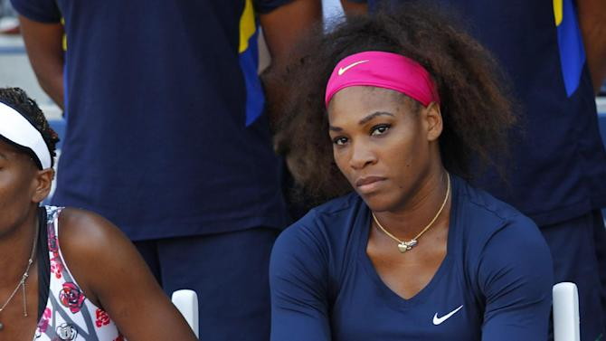 Serena Williams is assisted by a trainer after injuring herself during a doubles match in the second round of play at the 2012 US Open tennis tournament,  Wednesday, Aug. 29, 2012, in New York. (AP Photo/Paul Bereswill)
