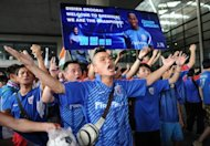 Shanghai Shenhua fans welcome Didier Drogba as he arrives at Pudong international airport in Shanghai on July 14. Drogba is the latest in a fast-growing number of foreign stars to have been lured to China on enormous salaries that are typically funded by Chinese business titans