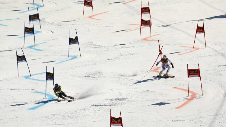 Shiffrin of the US competes with Feierabend of Switzerland during the Nation Team Event competition at the FIS Alpine Skiing World Cup finals in Lenzerheide