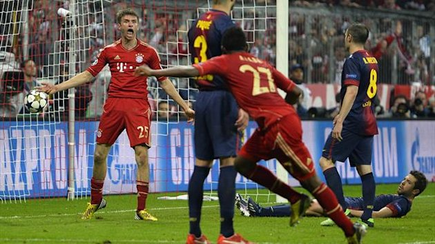 Thomas Mueller celebrates scoring for Bayern Munich against Barcelona (AFP)